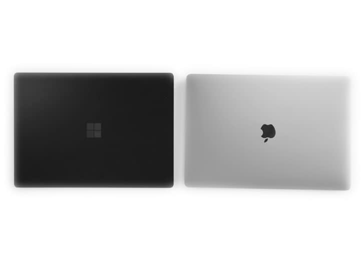 Microsoft Surface Pro 3 and a Macbook Pro side by side